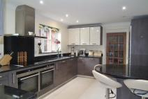 Detached house in Davis Road, Weybridge...