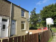 Terraced property in Ravenside Terrace...