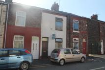 Terraced house in Greenway Road, Widnes