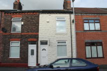 Terraced house in Cooper Street, Widnes