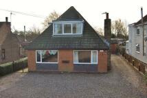 Detached house in Hull Bridge Road...