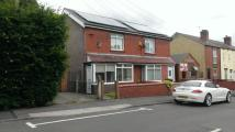 semi detached property in Station Road Garswood