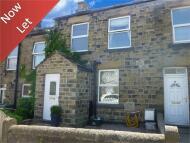 Terraced property in Huddersfield Road...