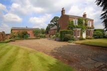 Detached property in Town Lane, Mobberley