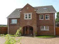 Detached property in Station Road, Wootton