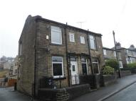 Terraced property in Dam Head Road...