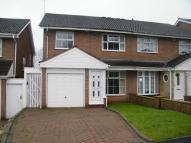 Terraced property in Glenmore Drive...
