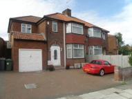 semi detached home for sale in Coniston Gardens, London...
