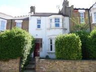 Terraced property in Pembroke Road, London...