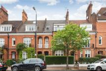 Terraced property in Albert Bridge Road...