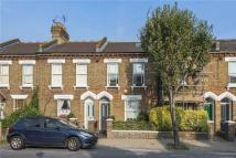 Terraced home for sale in Eversleigh Road, London...