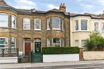 Terraced house in Quicks Road, London, SW19