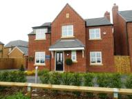 Detached home in Massey Close...