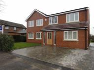 Detached property in Pasturefield Road...