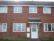 Terraced property in Woodman Mead, Warminster...