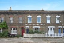 Terraced house in Robertson Street, London...