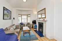 Terraced house in Ferndale Road, London...
