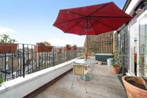 Flat for sale in Sinclair Road, London...