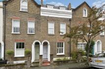 Terraced property in Lillian Road, London...