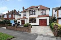Detached property in Friern Watch Avenue...