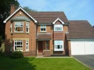 Detached home in Holywell Close...