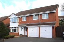 Detached house in Foxlydiate Lane...