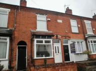 Sympathetically Refurbished Three Bedroom Mid Terraced Home home