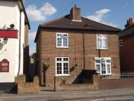 semi detached property in Chertsey, Surrey.