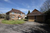Detached home in Birchwood Grove Road...