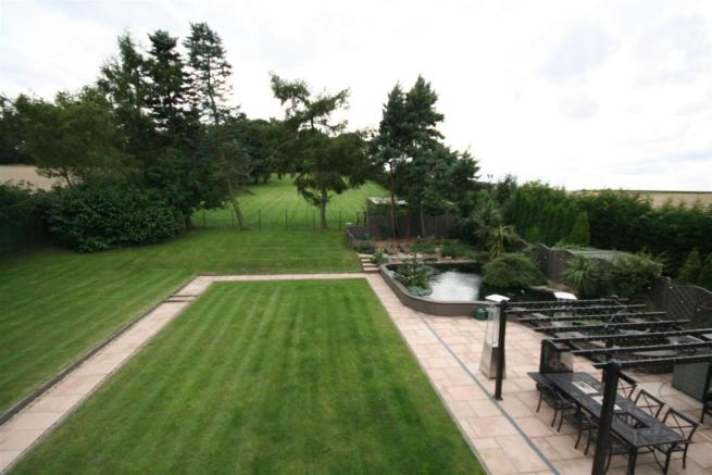 LANDSCAPED LAWNS TO REAR