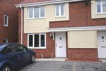 Terraced house in Swan Court, Castle View...