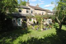 Detached property in Old Road, Mottram