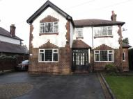 Detached property in Stockport Road, Marple...