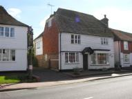 Detached property in High Street, Burwash...