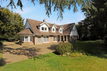 Detached home in Coombe Wood Road...