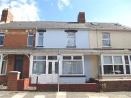 Terraced home in West Terrace, Penarth