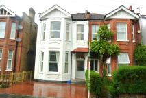 semi detached home for sale in Haydon Park Road, London
