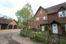Terraced house in Wellers Court, Shere...