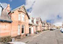 Terraced property in WEST HOLMES GARDENS...