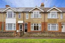 Terraced property in Downs Park Crescent...