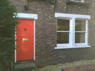 Terraced home in Usborne Mews, London...