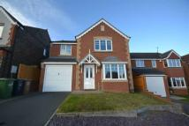 Detached home in Highclere Drive...