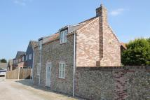 Detached property in Mill Street, Holt,
