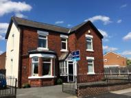 Detached property in Stockport Road, Denton...