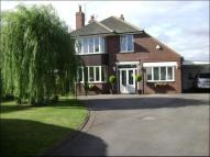 Detached home in Swinston Hill Road...