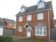 Detached home in Whisperwood Way...