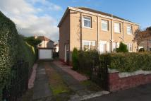 semi detached property in Barrachnie Road...