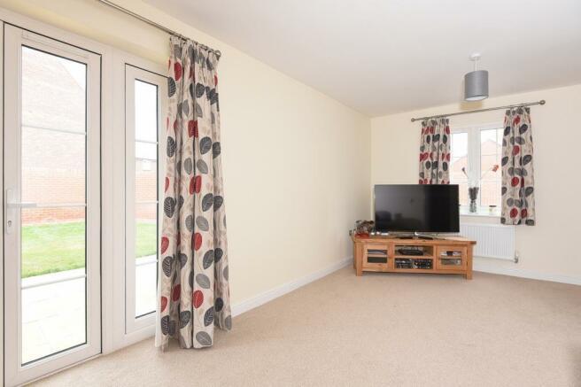 Living Room with Doors to Garden