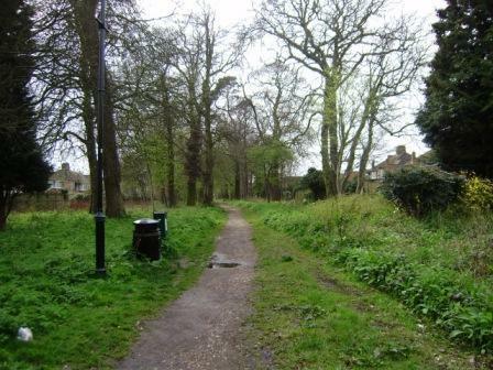 Woodland path bordering property