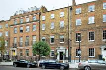 property in John Street, WC1N